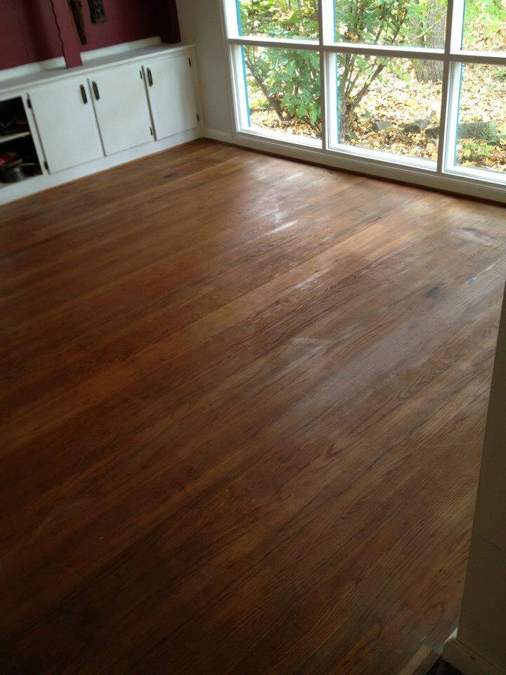 a wood floors with some scratches and dings in a galveston bedroom